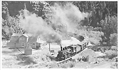 Leased D&amp;RGW #452 with an 11-car freight train on its way out of Placerville, rounding the big curve onto Bridge 27-A over Leopard Creek.<br /> RGS  Placerville, CO  Taken by Kindig, Richard H. - 9/5/1951