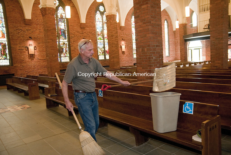 TORRINGTON, CT, 04  JUNE 15 - Roger Schieffert, a parishioner of St. Francis Church in Torrington, cleans up broken glass left by a vandal at the church Thursday.  Alec Johnson/ Republican-American