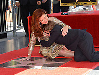 Debra Messing &amp; Roman Zelman at the Hollywood Walk of Fame Star Ceremony honoring actress Debra Messing on Hollywood Boulevard, Los Angeles, USA 06 Oct. 2017<br /> Picture: Paul Smith/Featureflash/SilverHub 0208 004 5359 sales@silverhubmedia.com