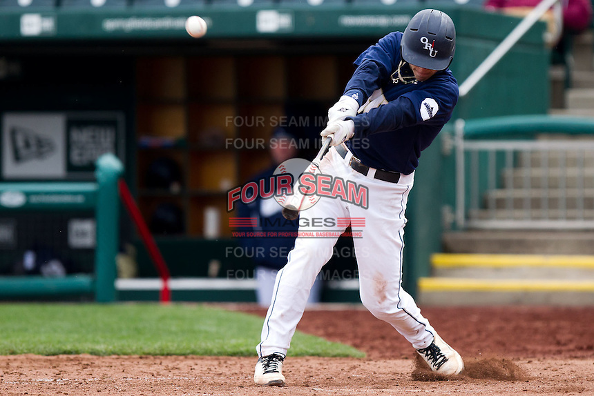Cam Schiller (9) of the Oral Roberts Golden Eagles makes contact with a pitch during a game against the Missouri State Bears on March 27, 2011 at Hammons Field in Springfield, Missouri.  Photo By David Welker/Four Seam Images
