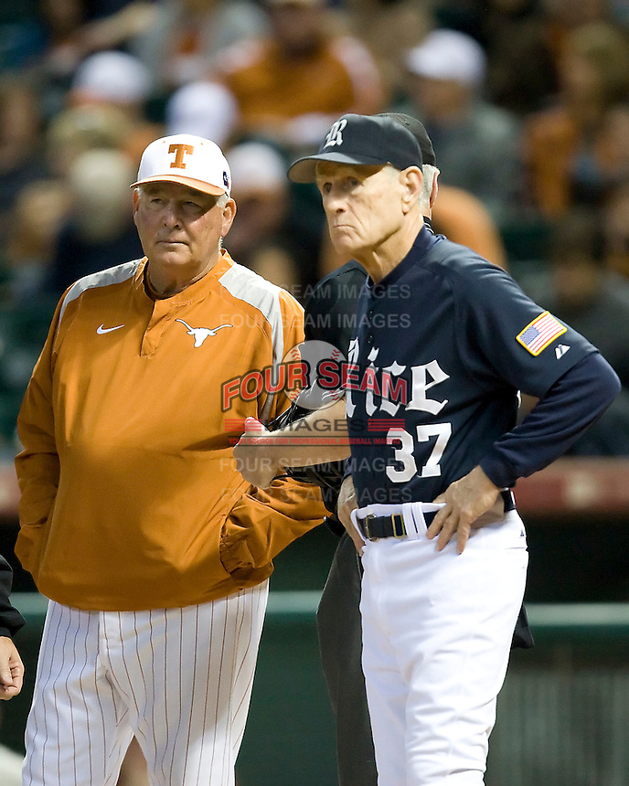 Texas Coach Augie Garrido meets with Rice coach Wayne Graham on Friday March 5th, 2100 at the Astros College Classic in Houston's Minute Maid Park.  (Photo by Andrew Woolley / Four Seam Images)