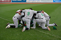 Clinton LumberKings players - including Christopher Torres (2), Thomas Jones (9), Samuel Castro (8) - pray before a Midwest League game against the Great Lakes Loons on July 19, 2019 at Dow Diamond in Midland, Michigan.  Clinton defeated Great Lakes 3-2.  (Mike Janes/Four Seam Images)