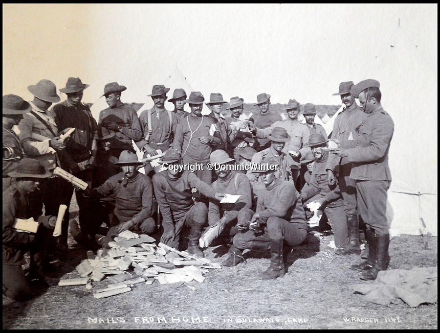 BNPS.co.uk (01202 558833)Pic: DominicWinter/BNPS<br /> <br /> Troops receive mail  - 'Mail from home' Bulawayo, Rhodesia (Zimbabwe) 1896 and 1900.<br /> <br /> These fascinating photos capture life in southern Africa at the end of the 20th century at a time of great uncertainty for the region.<br /> <br /> They were taken between 1896 and 1900 and cover the period of the Second Matabele War in Rhodesia, today known as Zimbabwe.<br /> <br /> One photo shows soldiers at a lookout with ammunition around their necks poised and ready to fire.<br /> <br /> Another image is of a laager, an encampment protected by a circle of wagons or armored vehicles.<br /> <br /> There is also the remarkable sight of troops lined up on bicycles and an imposing fort in the hills.