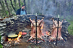 Roasting a steer over an open fire pit in Tres Valles, Patagonia, Argentina