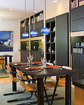 Black Cabinet Wall Connects Breakfast Area and Dining Room, Blue Pendant Lighting