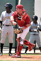 GCL Phillies catcher Joel Fisher (15) throws down to second in front of Eric Thomas (26) at bat during a game against the GCL Pirates on June 26, 2014 at the Carpenter Complex in Clearwater, Florida.  GCL Phillies defeated the GCL Pirates 6-2.  (Mike Janes/Four Seam Images)