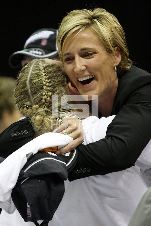 BERKELEY, CA - MARCH 30: Assistant coach Kate Paye celebrates with Jayne Appel following Stanford's 74-53 win against the Iowa State Cyclones on March 30, 2009 at Haas Pavilion in Berkeley, California.