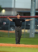 Field umpire makes a call during a Lake Mary Rams game against the Lake Brantley Patriots on April 2, 2015 at Allen Tuttle Field in Lake Mary, Florida.  Lake Brantley defeated Lake Mary 10-5.  (Mike Janes Photography)