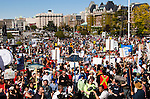 Thousands of protesters gather on the front lawn of the  Parliament Buildings in downtown Victoria, BC for the Get Out Migration Rally, May 8th, 2010.  The rally is the final stop for Alexandra Morton, who walked from Sointula to Victoria to protest open-net salmon  farming.  The Canadian Press Images/Gus Curtis