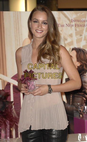 Leighton Meester .The launch of 'Vera Wang Lovestruck' at Harrods London, England..June 9th, 2011.half length beige sleeveless top bottle bracelet .CAP/WIZ.© Wizard/Capital Pictures.