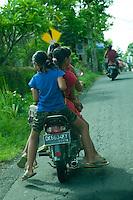 4 schoolkids on a motorbike. Keliki, Bali