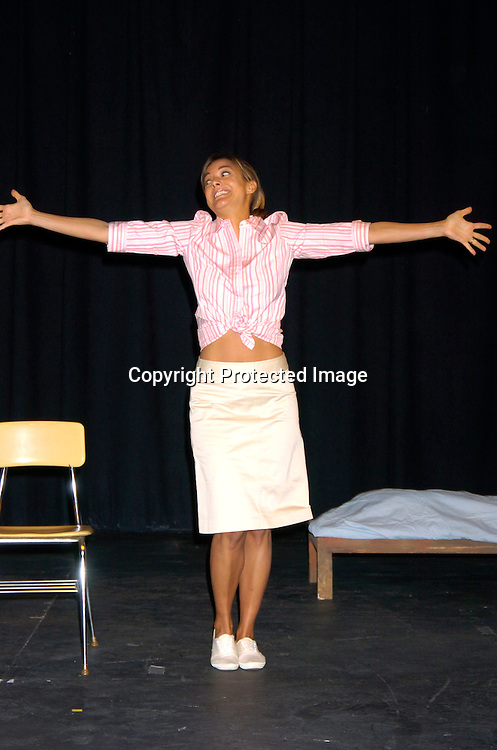 "Eva La Rue performing ..in ""The Women of Nine""  a trilogy of plays performed at ..Teatro LaTea in New York City. This was the dress rehearsal on March 24, 2004. The show will run March 24,..April 2, and April 4, 2004...Photo by Robin Platzer, Twin Images"