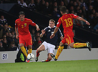 James Forrest tackles Goran Popov (3) as Muhamed Demiri covers in the Scotland v Macedonia FIFA World Cup Qualifying match at Hampden Park, Glasgow on 11.9.12.