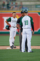 Fort Wayne TinCaps base runner Jawuan Harris (2) looks on as manager Anthony Contreras (10) argues a call with umpire Thomas Burrell during a Midwest League game against the Peoria Chiefs on July 17, 2019 at Parkview Field in Fort Wayne, Indiana.  Fort Wayne defeated Peoria 6-2.  (Mike Janes/Four Seam Images)