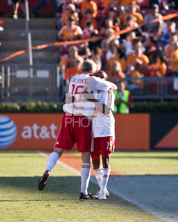 New York Red Bulls forward John Wolyniec (15) and midfielder Dane Richards (19) celebrate a goal.  New York Red Bulls defeated Houston Dynamo 3-0 for an aggregate  score of 4-1 over Houston Dynamo   at Robertson Stadium in Houston, TX on November 9, 2008 in the second leg of the Western Conference semifinals.  Photo by Wendy Larsen/isiphotos.com