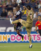 New England Revolution midfielder Sainey Nyassi (17) attempts to connect with long pass as Philadelphia Union defender Danny Califf (4) defends. The Philadelphia Union defeated New England Revolution, 2-1, at Gillette Stadium on August 28, 2010.
