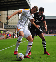 Port Vale's Luke Hannant shields the ball from Lincoln City's Matt Green<br /> <br /> Photographer Andrew Vaughan/CameraSport<br /> <br /> The EFL Sky Bet League Two - Port Vale v Lincoln City - Saturday 14th April 2018 - Vale Park - Burslem<br /> <br /> World Copyright &copy; 2018 CameraSport. All rights reserved. 43 Linden Ave. Countesthorpe. Leicester. England. LE8 5PG - Tel: +44 (0) 116 277 4147 - admin@camerasport.com - www.camerasport.com