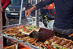 Istanbul - Turkey - 05 February 2015 -- Young entrepreneurs. -- Ferdi Esiyok,17, fish kebab seller grills the fish -- PHOTO: Agata SKOWRONEK / EUP-IMAGES