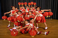 A group of young girls dance while holding up Chinese lanterns during a Chinese New Year Celebration at UNC Charlotte in Charlotte, NC.