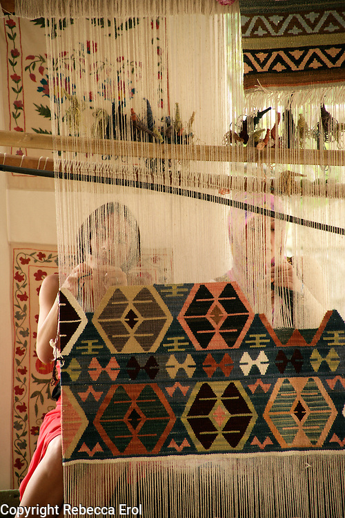 Weaving a kilim together, Goreme, Turkey