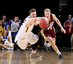 SIOUX FALLS, SD - MARCH 7:  Ian Theisen #42 of South Dakota State and Joe Rosga #2 of Denver fight for the ball in the 2016 Summit League Tournament.  (Photo by Dave Eggen/Inertia)