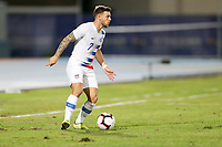 GEORGETOWN, GRAND CAYMAN, CAYMAN ISLANDS - NOVEMBER 19: Paul Arriola #7 of the United States looks for an open man downfield during a game between Cuba and USMNT at Truman Bodden Sports Complex on November 19, 2019 in Georgetown, Grand Cayman.