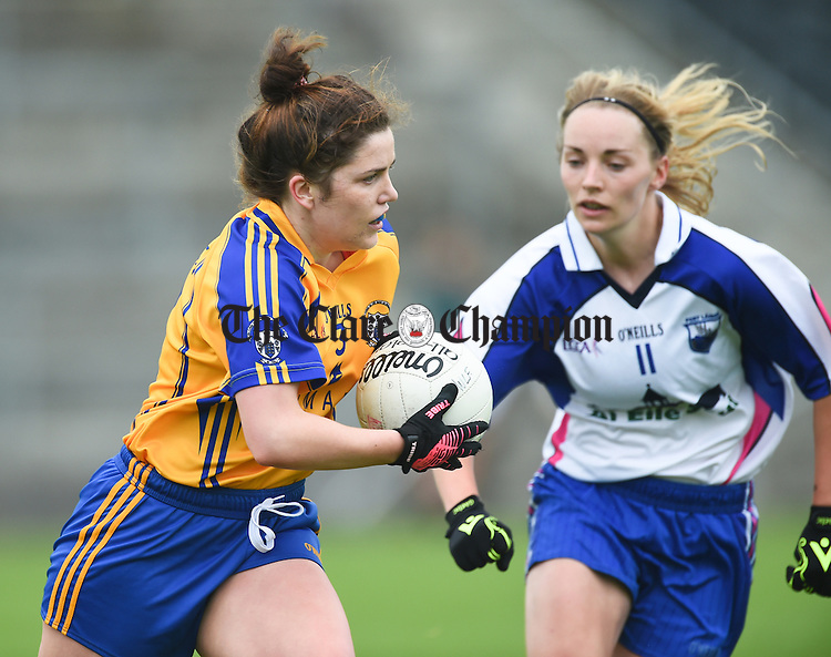 Laurie Ryan of Clare in action against Maria Delahunty of Waterford during their Munster Intermediate Football final at Mallow. photograph by John Kelly.