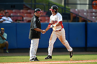 Illinois State Redbirds Paul DeJong (14) shakes hands with coach Mike Stalowy after hitting a home run during a game against the Bowling Green Falcons on March 11, 2015 at Chain of Lakes Stadium in Winter Haven, Florida.  Illinois State defeated Bowling Green 8-7.  (Mike Janes/Four Seam Images)