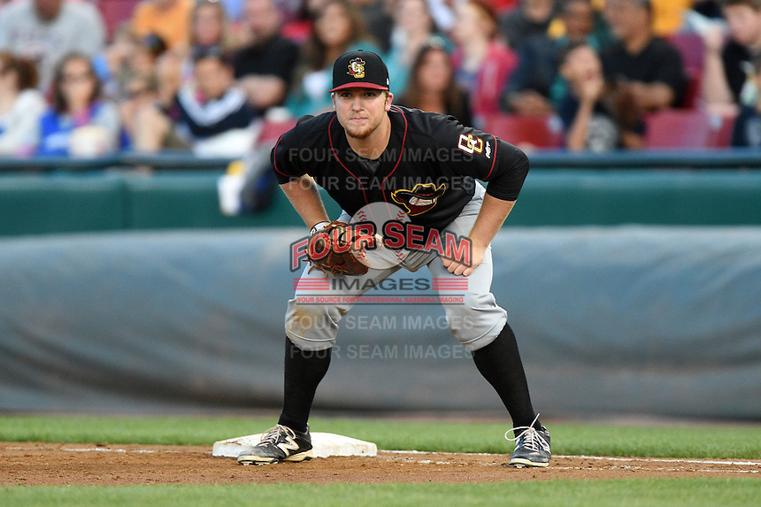 Quad Cities River Bandits first baseman A.J. Reed (18) holds a runner on during a game against the Kane County Cougars on August 14, 2014 at Third Bank Ballpark in Geneva, Illinois.  Kane County defeated Quad Cities 4-1.  (Mike Janes/Four Seam Images)