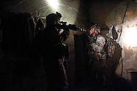 US soldiers from Alfa companny, 1st battalion, 506th regiment, 101st airborne division search for weapons in a suspected insurgents hide out while conducting opearation Hudini, a dismounted ( on foot) raid with the purpose of finding enemy weapons, ammunitions and engaging the insurgency on FRI Jan 13 2006 in Ramadi, Al Anbar Province, Iraq. Alfa company left its forward operationg base named combat outpost at 0500 AM with an initial plan of returning after a few hours. after navigating in the misty riverside until the sun raised they raided a compound finding more than 900 pounds of enemy ammunitions burried in its perimeter. after the engeneers attached to the unit retreived all the explosives alfa company begun reciving mortars and small arm fire from the opposite side of the river. the unit had to remain on location to secure the area until the engineers detonated the cache. Meanwhile CPT Roberts, alfa ccompany's commanding officer was launching patrols in the area discovering a 500 pound improvvised explosive device on a road side that later was detonated by a Marine EOD bomb squad. during exctraction the unit exchanged fire on the open with the insurgency and after 12 hours they returned to their base.