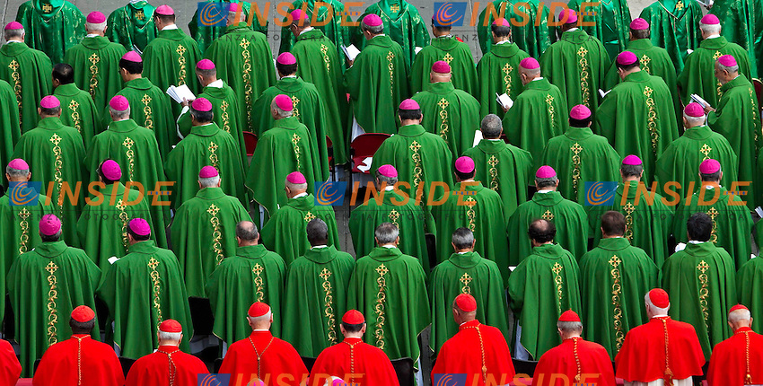 Cardinals and  bishops attend a mass in St. Peter's Square for the opening of the Synod of Bishops held by Pope Benedict XVI on October 7, 2012 in Vatican City, Vatican. Pontiff named today Spanish St John of Avila and German St Hildegard of Bingen as 'Doctors of the Church'