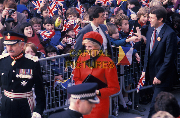 "HRH, THE PRINCESS DIANA OF WALES.Arrives to launch P & O's new Cruise Ship called the ""Royal Princess"" in her honour, Southampton Docks England, November 15, 1984..Lady Di family her royal highness half length red cap hat jacket black neck tie scarf coat naming of boat P&O crowd waving Union Jack Fags.Ref: CAP/PL.©Phil Loftus/Capital Pictures"