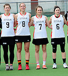 FRANKFURT AM MAIN, GERMANY - April 14: Kristina Schaefer #9 of Germany, Inga Hupka #8 of Germany, Pia Balz #7 of Germany and Mareile Kriwall #6 of Germany during the national anthem before the Deutschland Lacrosse International Tournament match between Germany vs Great Britain during the on April 14, 2013 in Frankfurt am Main, Germany. Great Britain won, 10-9. (Photo by Dirk Markgraf)