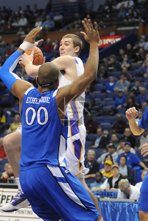 March 4,  2011                         Northern Iowa Panthers forward Jake Koch (20, behind) leaps high to make a pass over Creighton center Gregory Echenique (00, foreground) in the first half. Northern Iowa played Creighton in the second quarterfinal game of the NCAA Missouri Valley Conference Men's Basketball Tournament on Friday March 4, 2011 at the Scottrade Center in downtown St. Louis.