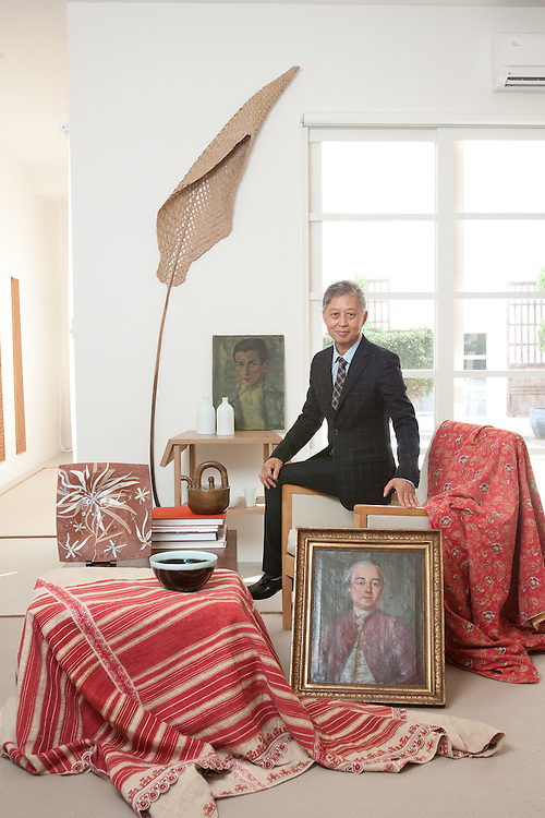 Adelaide furniture Designer Khai Liew in his home  with a collection of his favorite design piece's.