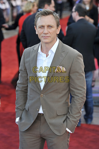 Daniel Craig.UK Premiere of 'Cowboys and Aliens' at the Cineworld cinema at the O2 Arena, London, England..August 11th 2011.half length beige suit white shirt hands in pockets .CAP/MAR.© Martin Harris/Capital Pictures.