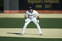 Adam Cecere (18) of the Wake Forest Demon Deacons takes his lead off of first base against the Louisville Cardinals at David F. Couch Ballpark on March 7, 2020 in  Winston-Salem, North Carolina. The Demon Deacons defeated the Cardinals 3-2. (Brian Westerholt/Four Seam Images)