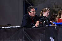 University of Nebraska distance coach, Warrensburg high school and Northeast Missouri State runner and former Jefferson City High School and Emporia State coach David Harris watches as two of his athletes run in the womens 10k at the 2015 Kansas Relays.