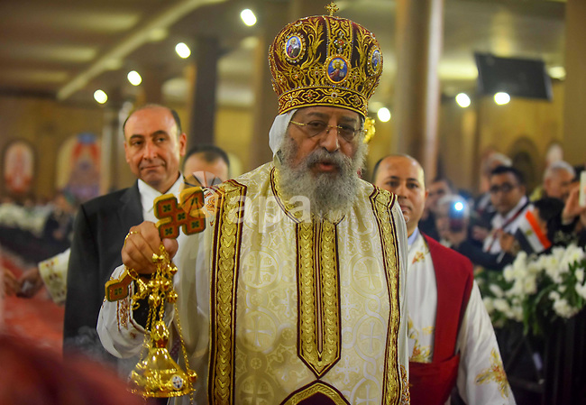 Egypt Coptic Pope Tawadros II leads the Christmas Eve mass at the Nativity of Christ Cathedral in Cairo on January 6, 2018. Coptic Orthodox Christians packed the newly built Nativity of Christ Cathedral for a Christmas Eve mass after a bloody year for the minority singled out by jihadists for attacks. Photo by Amr Sayed
