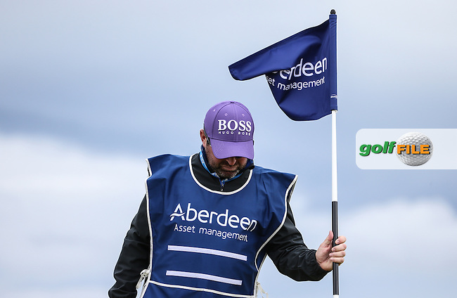 Wee Man Craig Connelly replaces the pin-flag on the 9th  during Round One of the 2016 Aberdeen Asset Management Scottish Open, played at Castle Stuart Golf Club, Inverness, Scotland. 07/07/2016. Picture: David Lloyd | Golffile.<br /> <br /> All photos usage must carry mandatory copyright credit (&copy; Golffile | David Lloyd)