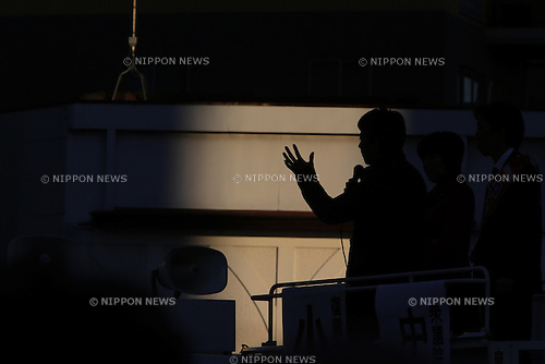Japan's ruling Liberal Democratic Party (LDP) lawmaker  Shinjiro Koizumi is silhouetted as he delivers a speech atop a campaign car to support  a candidate in Kawasaki city, Japan, on Saturday, December 13, 2014.  (Photo by Yuriko Nakao/AFLO)