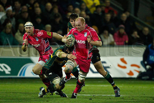 2010 Heineken Cup Rugby Northampton Saints v Cardiff Blues Dec 11th. Martyn Williams is tackled by Phil Dowson