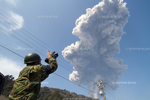 February 4, 2011, Takahara Township, Japan - A Japanese Ground Self-Defense Force soldier takes pictures from Takahara township of Shinmoe-dake, a volcano on the border of Kagoshima and Miyazaki prefectures in southwestern Japan, as it erupts on Friday, February 4, 2011. (Photo by AFLO) [3609] -mis-