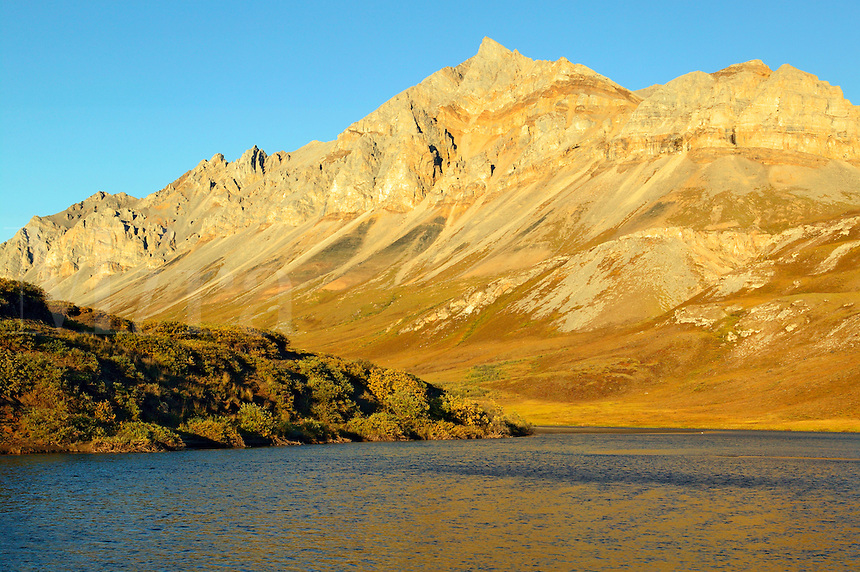The Atigun River Gorge cuts through the Brooks Range and the Philip Smith Mountains along the western boundary of the Arctic National Wildlife Refuge or ANWR, Alaska