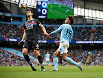 Leroy Sane of Manchester City lifts the ball over Scott Dann of Crystal Palace to score the first goal during the premier league match at the Etihad Stadium, Manchester. Picture date 22nd September 2017. Picture credit should read: Simon Bellis/Sportimage