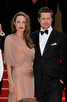ANGELINA JOLIE &amp; BRAD PITT<br /> The &quot;Inglourious Basterds&quot; Premiere at the Grand Theatre Lumiere during the 62nd Annual Cannes Film Festival, Cannes, France.<br /> May 20th, 2009<br /> length half 3/4 dress sheer wrap beige pink cream black tuxedo couple goatee facial hair slit split thigh red lipstick hand in pocket <br /> CAP/PL<br /> &copy;Phil Loftus/Capital Pictures /MediaPunch ***NORTH AND SOUTH AMERICAS ONLY***