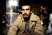 A young Hazara Mujahedin Commander in  the Hezb e Wahdat Islami force, of Karim Kalili, in a tea House, in Bamiyan.