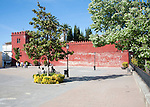 Moorish red castle walls in Plaza de la Constitucion, Alhama de Granada, Spain