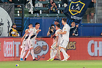 CARSON, CA - SEPTEMBER 15: Joe Corona #14 and the Los Angeles Galaxy celebrates a goal during a game between Sporting Kansas City and Los Angeles Galaxy at Dignity Health Sports Complex on September 15, 2019 in Carson, California.