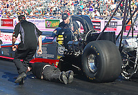 Oct 30, 2015; Las Vegas, NV, USA; Crew member Barry Paton lays on ground after being run over by the car of NHRA top fuel driver Tim Boychuk during qualifying for the Toyota Nationals at The Strip at Las Vegas Motor Speedway. Mandatory Credit: Mark J. Rebilas-USA TODAY Sports